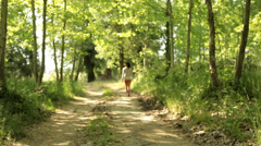 Sexy Woman walking away from camera in natural background relax emotion happy Stock Footage
