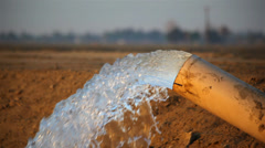 Water Pouring From Farm Pipe Stock Footage