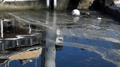 Polluted River Dirty water running through city stream Stock Footage