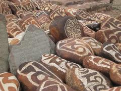 stone carved with symbols of prosperity - stock photo
