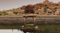 A Hhindu monument in a pond Stock Footage