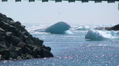 Icebergs flowing out to the ocean underneath the bridge Stock Footage