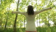 Sexy Woman looking at nature and raising arms, vacations happy - Tracking shot - stock footage