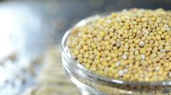 Mustard seeds (loopable) Stock Footage