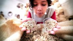 Hispanic woman smelling green coffee beans Stock Footage