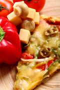 Closeup of tasty italian pizza with vegetables - stock photo