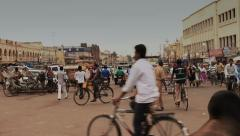 A busy street in India with cows, rickshaws, bicycles, men, women and more. Stock Footage