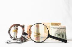 Tax crime concept money and handcuff Stock Photos