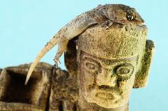 gecko lizard and mayan statue - stock photo