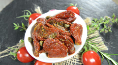 Portion of dried tomatoes (not loopable) Stock Footage