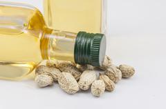 peanuts and two bottle of oil - stock photo
