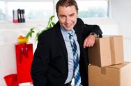 Stock Photo of Middle aged businessman at his relocated office