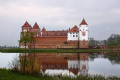 Mir castle in belarus and its reflection in a lake Stock Photos