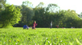 Sunny day in park, people, children walking, playing with kite.  Dolly. Footage