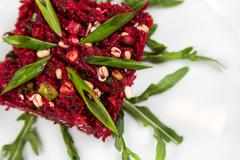 uncooked vegetarian salad with beetroot and greensprouting seed - stock photo