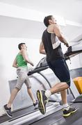 Two guys on treadmill Stock Photos