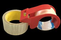 transparent adhesive tape with plastic tape handler - stock photo