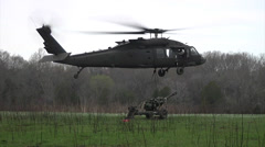 Helicopter and Artillery at Operation Golden Eagle 2014 - stock footage