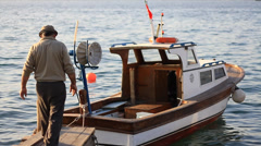Fisherman and the fisherboat Stock Footage