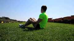 Handsome athlete doing abdominal exercise Stock Footage