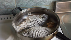 Two crucian fried in a pan Stock Footage