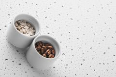 set of saucers filled with coffee beans and sweet candy - stock photo