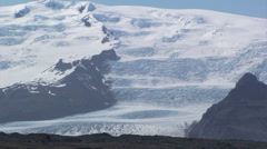Full view of glacier filling a valley with moraines in the foreground Stock Footage