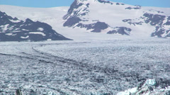 Medial moraines and crevasses on pan on a wide glacier Stock Footage