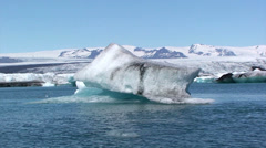 Large iceberg in front of the shore blocks view to glacier Stock Footage