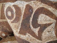 Single stone carved with symbols of prosperity - stock photo