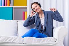 woman listening pop music - stock photo