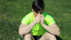 Young athlete with allergy sneezing Stock Footage