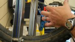 2.5K Repairman at Work in Bicycle / Bike Shop 2 (Close Up) Stock Footage