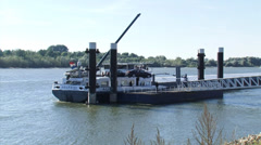 River Rhine - Hoisting up a car from a ship to a pier - wide shot Stock Footage
