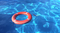 Life buoy blue water Stock Footage
