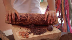 Grinding cocoa in Mexican metate - stock footage