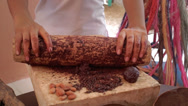 Stock Video Footage of Grinding cocoa in Mexican metate
