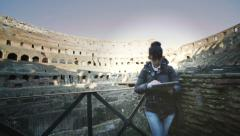 Woman using tablet inside the roman ruins Stock Footage