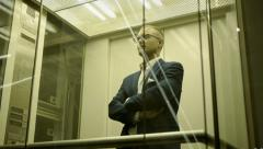 Businessman standing in elevator. professional sales person. man male Stock Footage