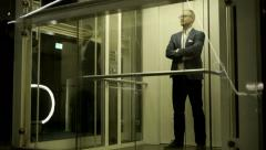 Stock Video Footage of businessman standing in glass elevator. career. business. success. male person