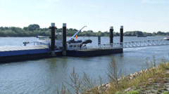 River Rhine - Hoisting up a car from car dock pier to a ship - wide shot Stock Footage