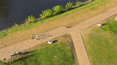 folks in city park; above view at sunny evening - stock footage