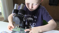 Child, first encounter with microscope, early learning Stock Footage