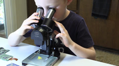 Child, first encounter with microscope, breakfast cereal Stock Footage