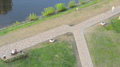 folks in city park; above view - stock footage