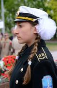 Young girl in sailor uniform standing in guard of honour at victory day Stock Photos