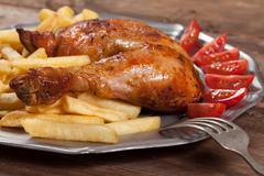 Roasted chicken leg. Stock Photos