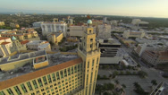Stock Video Footage of Circling a tall building and tower in the heart of downtown Coral Gables