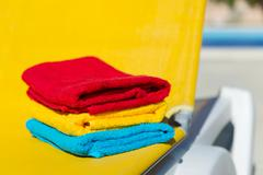 Yellow bed at swimming pool Stock Photos