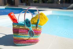 Vacation at the swimming pool Stock Photos